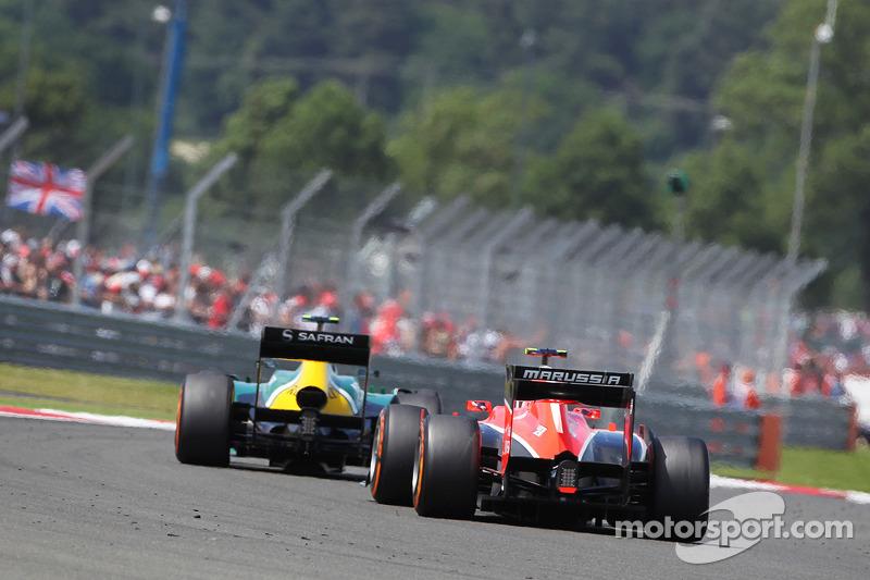 Giedo van der Garde Caterham CT03 leads Max Chilton Marussia F1 Team MR02
