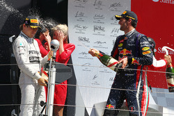 Race winner Nico Rosberg Mercedes AMG F1 celebrates on the podium with second placed Mark Webber Red Bull Racing