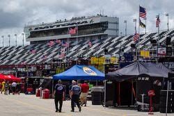 American flags wave over Daytona International Speedway garage area