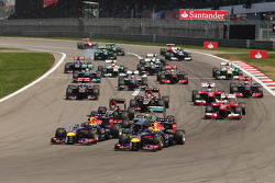Sebastian Vettel, Red Bull Racing RB9 and Mark Webber, Red Bull Racing RB9 lead at the start of the race