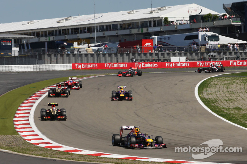 Sebastian Vettel, Red Bull Racing RB9 leads as Mark Webber, Red Bull Racing RB9 passes the field under the Safety Car