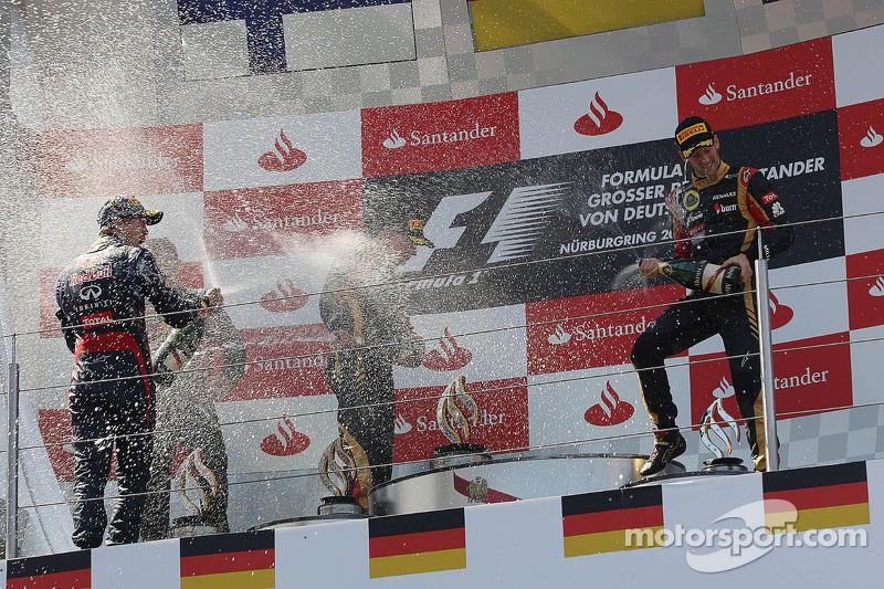 (L to R): race winner Sebastian Vettel, Red Bull Racing celebrates on the podium with Kimi Raikkonen, Lotus F1 Team and Romain Grosjean, Lotus F1 Team