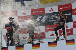 (L to R): race winner Sebastian Vettel, Red Bull Racing celebrates on the podium with Kimi Raikkonen, Lotus F1 Team and Romain Grosjean, Lotus F1 Team