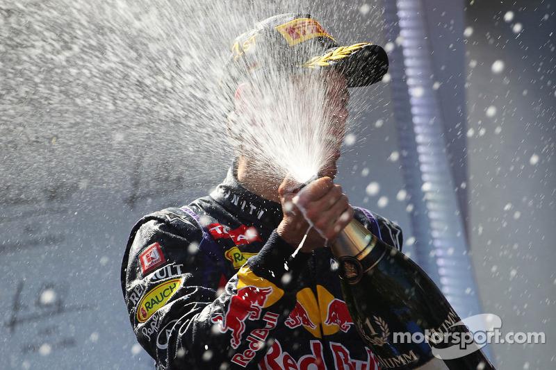 Race winner Sebastian Vettel, Red Bull Racing RB9 celebrates with the champagne on the podium