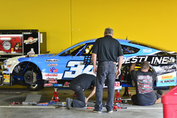 Crews work on the #34 TA2 Ford Mustang: Tony Buffomante of Mike Cope Racing Enterprises