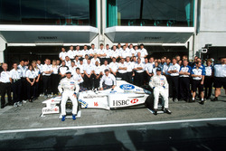 The Stewart team celebrate their first victory in F1