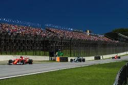 Sebastian Vettel, Ferrari SF70H leads Valtteri Bottas, Mercedes-Benz F1 W08  and Kimi Raikkonen, Ferrari SF70H