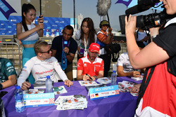 Felix Rosenqvist, Mahindra Racing, Nick Heidfeld, Mahindra Racing, sign autographs for fans