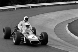 Denny Hulme gives a lift to Jack Brabham