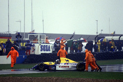 Damon Hill, Williams FW15C, is pushed off the track by marshals