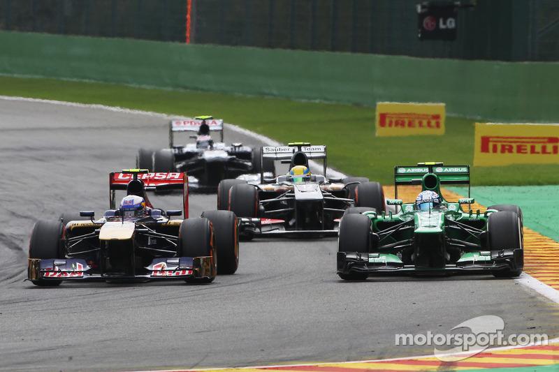 Daniel Ricciardo, Scuderia Toro Rosso with Giedo van der Garde, Caterham