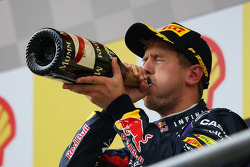 Race winner Sebastian Vettel, Red Bull Racing celebrates with the champagne on the podium