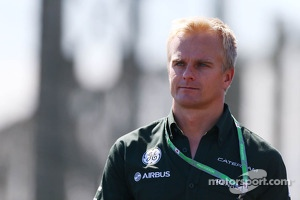 Heikki Kovalainen, Caterham F1 Team Reserve Driver walks the circuit