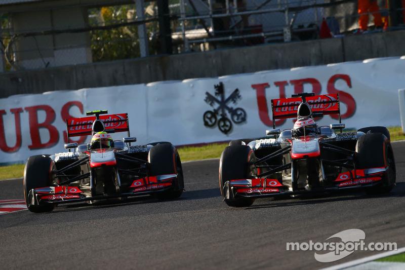 Sergio Perez, McLaren MP4-28 and Jenson Button, McLaren MP4-28