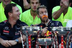 (L to R): Christian Horner, Red Bull Racing Team Principal and race winner Sebastian Vettel, Red Bull Racing celebrate with the team