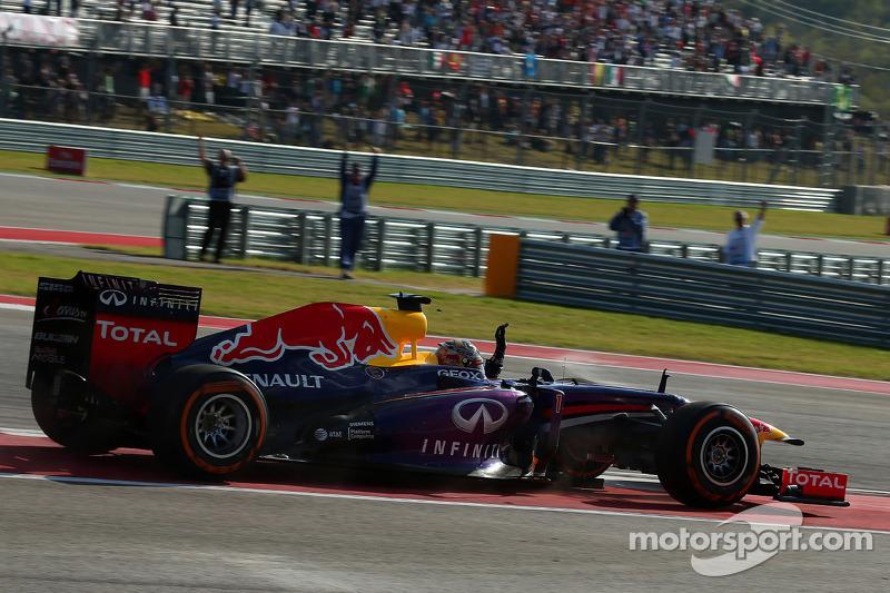 Race winner Sebastian Vettel, Red Bull Racing RB9 celebrates at the end of the race