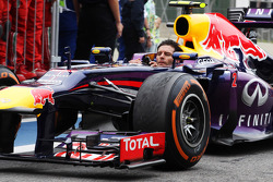 Second placed Mark Webber, Red Bull Racing RB9 arrives in parc ferme without his helmet