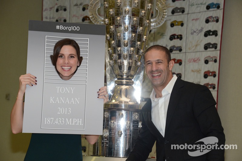 Tony Kanaan and wife Lauren play around during the presentation of his likeness on the Borg-Warner Trophy