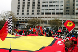 Ferrari fans show support for Michael Schumacher in front of the Grenoble University Hospital following his ski accident