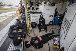 OAK Racing team members have a nap between two pit stops
