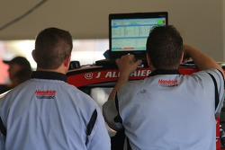 Hendrick engine technicians work in the garage