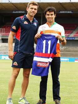(L to R): Shaun Higgins, Western Bulldogs Australian Rules Footballer presents a team jersey to Sergio Perez, Sahara Force India F1 at Whitten Oval