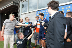 Will Minson, Western Bulldogs Australian Rules Footballer and Nico Hulkenberg, Sahara Force India F1 with the media at Whitten Oval