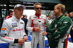 (Da sinistra a destra): Kevin Magnussen, McLaren con Max Chilton, Marussia F1 Team e Marcus Ericsson, Caterham