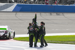Joe Gibbs Racing crew members celebrate Kyle Busch's win