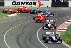 Mika Hakkinen, McLaren leads David Couthard, McLaren at the start