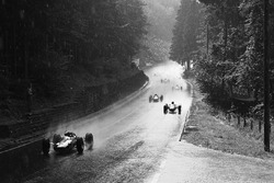 Jim Clark, Lotus 33, leads the field in the rain