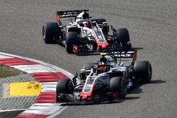Kevin Magnussen, Haas F1 Team VF-18 and Romain Grosjean, Haas F1 Team VF-18