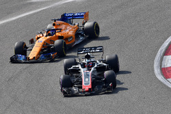 Romain Grosjean, Haas F1 Team VF-18 and Fernando Alonso, McLaren MCL33