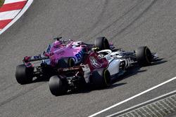 Charles Leclerc, Sauber C37 and Sergio Perez, Force India VJM11