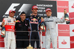 Podium: second place Lewis Hamilton, McLaren, Peter Prodromou, Red Bull Racing Head of Aerodynamics, Race winner Mark Webber, Red Bull Racing, third place Nico Rosberg, Mercedes GP