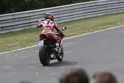 Carlos Checa rides a Ducati around the Nordschleife