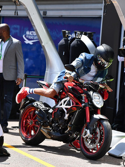 Lewis Hamilton, Mercedes AMG F1 arrives at the track on his MV Agusta motorbike