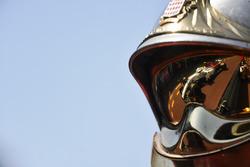 Charles Leclerc, Sauber C37 reflected in a fireman helmet