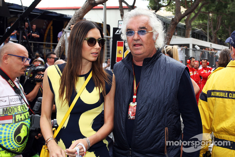 Flavio Briatore, with wife Elisabetta Gregoraci, on the grid