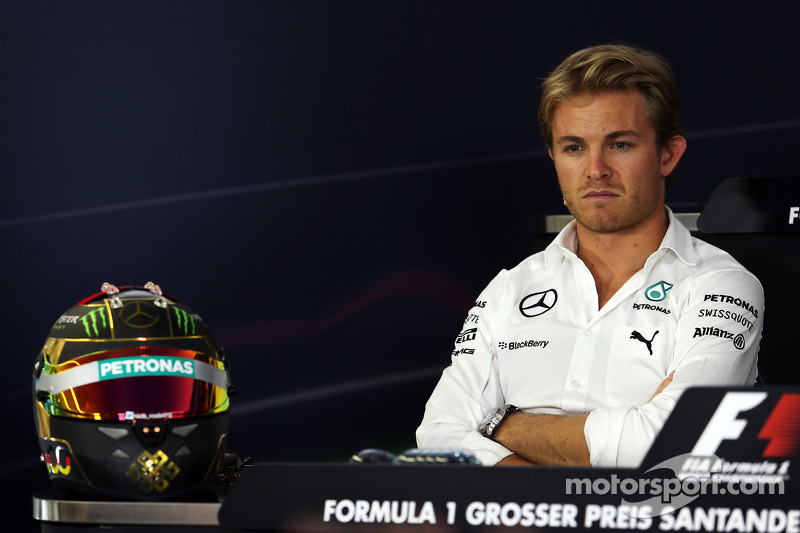 Nico Rosberg, Mercedes AMG F1 in the FIA Press Conference with his World Cup celebrating helmet