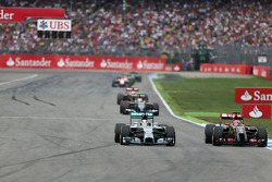 Lewis Hamilton, Mercedes AMG F1 Team and Romain Grosjean, Lotus F1 Team