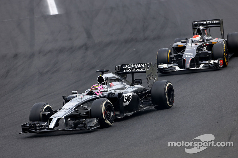 Jenson Button, McLaren F1 Team; Adrian Sutil, Sauber F1 Team