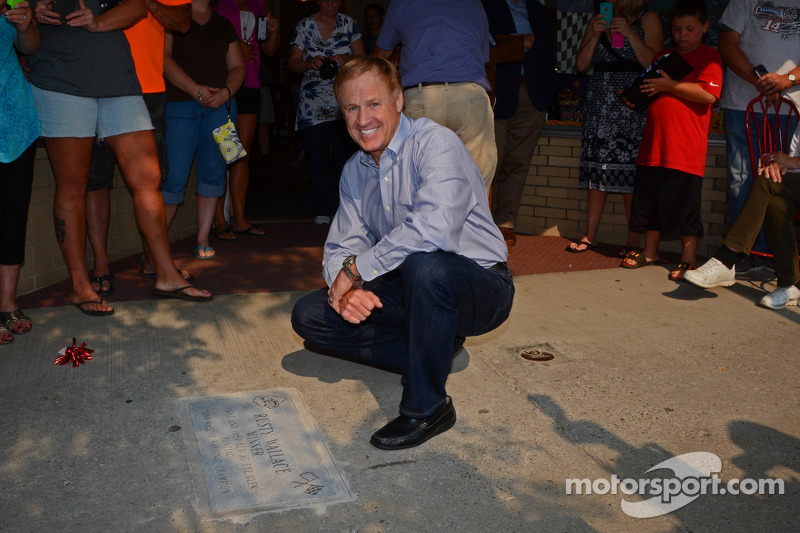 Rusty Wallace poses alongside his commemorative sidewalk plaque