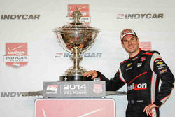 Championship winner Will Power celebrates