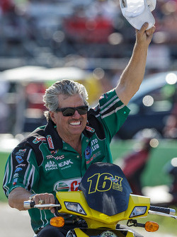 John Force celebrates his daughter Courtney's victory in Top Fuel Funny Car