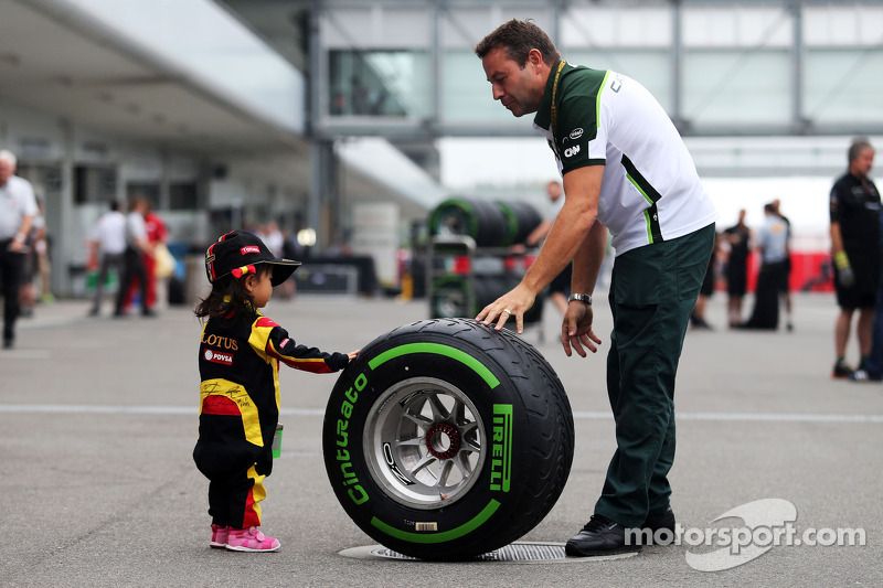 A young fan with a Pirelli tyre