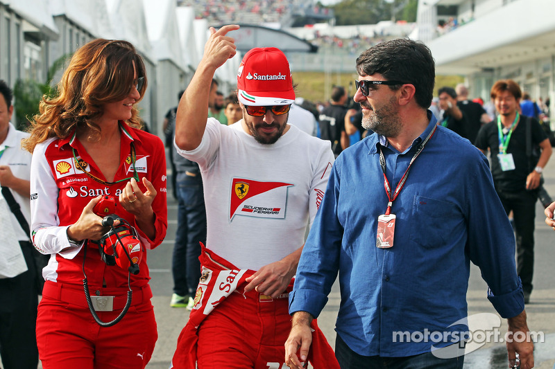 (L to R): Roberta Vallorosi, Ferrari Press Officer with Fernando Alonso, Ferrari and Luis Garcia ...