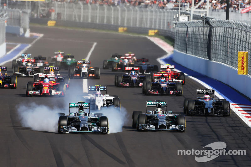 Nico Rosberg, Mercedes AMG F1 locks up under braking beside team mate Lewis Hamilton, Mercedes AMG F1 W05 at the start of the race