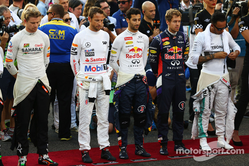 (L to R): Nico Hulkenberg, Sahara Force India F1; Jenson Button, McLaren; Daniel Ricciardo, Red Bull Racing; Sebastian Vettel, Red Bull Racing; and Lewis Hamilton, Mercedes AMG F1 observe the anthem on the grid