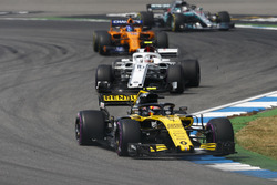 Carlos Sainz Jr., Renault Sport F1 Team R.S. 18, leads Charles Leclerc, Sauber C37, and Fernando Alonso, McLaren MCL33